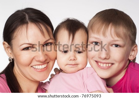 mom and her children on a white background