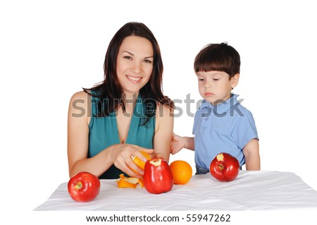 Mom and her young son together eat fruits