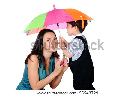 Mom and her young son together under an umbrella. On a white background. - stock photo