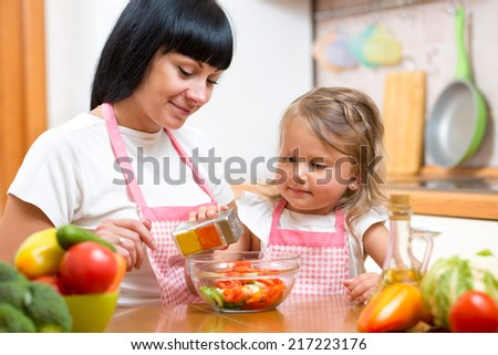 mom and kid girl preparing healthy food - stock photo