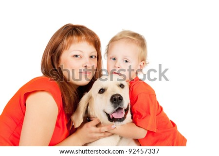 Mom and son are sitting with a dog