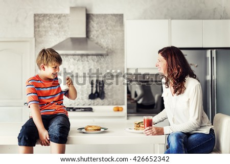 Mom and Son Eating Togetherness Cheerful Concept - stock photo