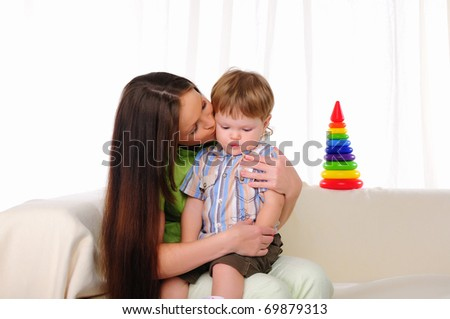 Mom and son having fun together. Symbol of the family. - stock photo