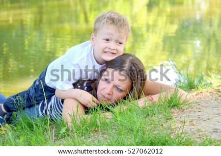 mom and son in nature