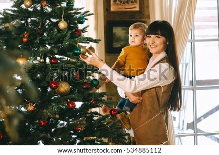 decorating with christmas family decorating christmas tree young man stock photo 737844109