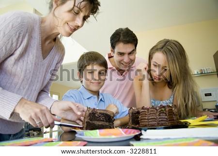 Mom cutting cake - stock photo