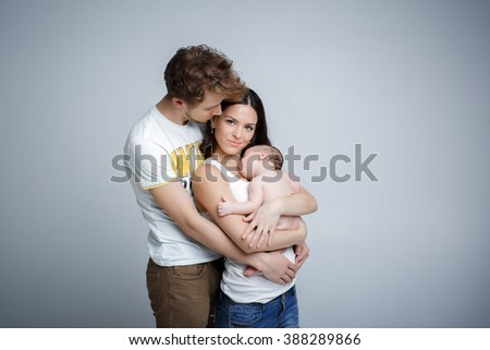 mom dad and baby. Loving parents with their cute little son - stock photo