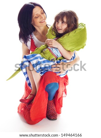 Mom daughter and a toy crocodile isolated on white background - stock photo
