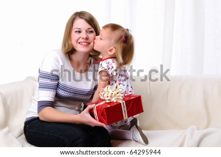 Mom gives daughter gift in red box
