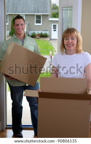 Mom Helping Her Son Move Into His First Home Carrying Boxes Through The Front Door