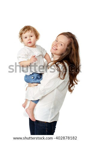 Mom holding the baby in her arms in white shirts and jeans on a white background isolated - stock photo