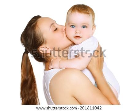Mom kissing baby - stock photo