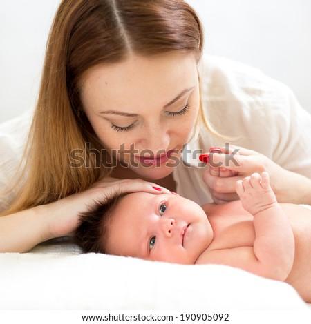 mom looking at her newborn baby - stock photo