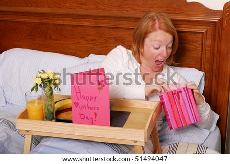 Mom opening gift on Mothers Day