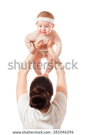 Mom raised her baby above her head . mother playing with her baby - stock photo