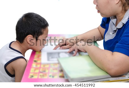 Mom teaching boy for reading.Attention Deficit Hyperactivity Dis - stock photo