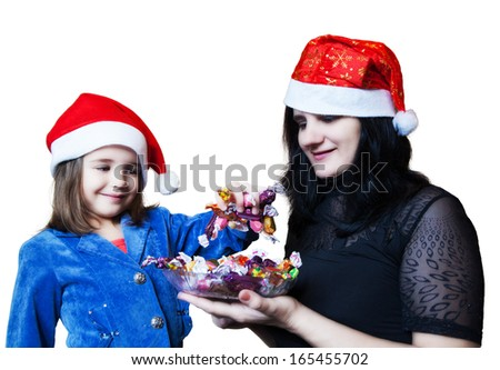mom treats her daughter candy  in Christmas