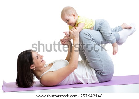mom with baby do gymnastic and fitness exercises - stock photo