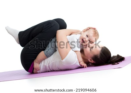 mom with child do gymnastic and fitness exercises - stock photo