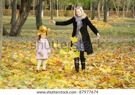 mom with her daughter playing at park