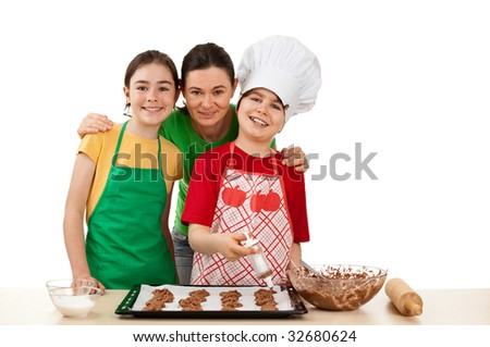 Mom with kids making cakes - stock photo
