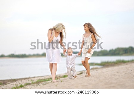Mom with son and daughter in summer nature - stock photo