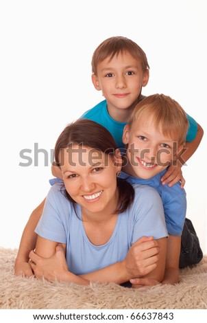 mom with two boys on a light background
