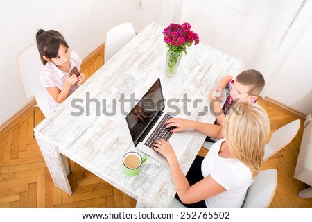 Mom working at home - stock photo