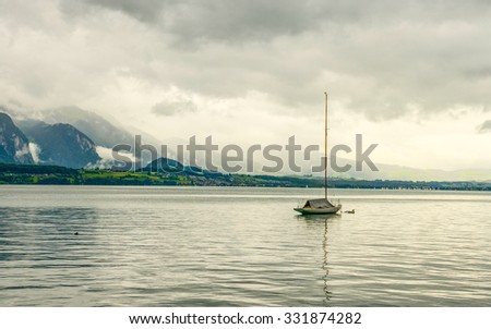 Moment After The Sunset With Foggy Clouds And A Peaceful Water Of The Lake - stock photo