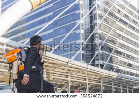 Moment middle aged Businessman running fast upstairs. Horizontal outdoors shot,image leg walking up stairs in city to success,Space for copy text.