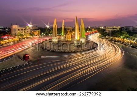 Moment of Democracy monument at twilight (Bangkok, Thailand) - stock photo