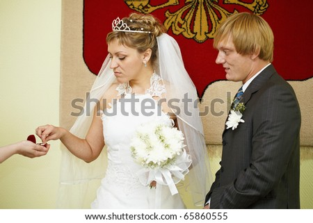 Moment of wearing of wedding rings - stock photo