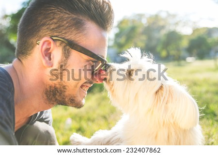 moments of love between dog and his owner. concept about pets and animals - stock photo
