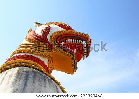 Mon Lion Statue in Sangkhlaburi on clear blue sky