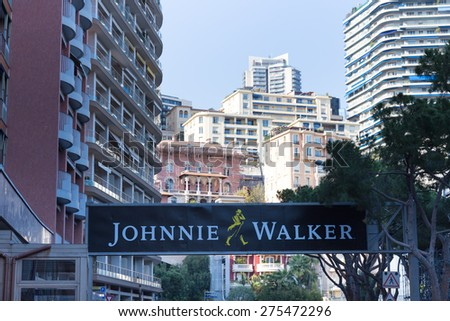 MONACO - APRIL 13, 2015: Johnnie Walker ad for the Monaco Grand Prix 2015. The Monaco Grand Prix is a Formula 1 motor race held on Circuit de Monaco, a narrow course laid out in the streets of Monaco. - stock photo
