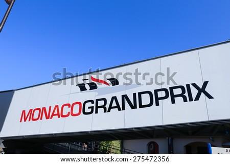 MONACO - APRIL 13, 2015: Monaco Grand Prix logo on a pedestrian bridge. The Monaco Grand Prix is a Formula One motor race held on Circuit de Monaco, a narrow course laid out in the streets of Monaco. - stock photo