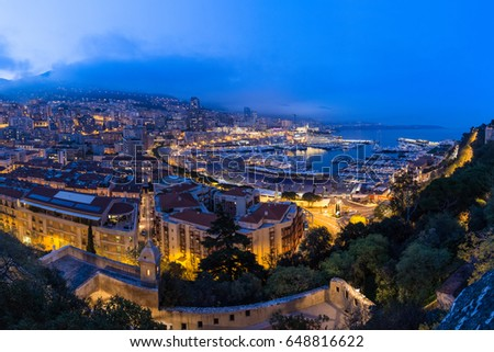 MONACO - APRIL 13, 2015: Panorama shot in the evening of the Monaco Harbour and preparations for the Monaco Grand Prix 2015. The Grand Prix is a Formula One motor race held on Circuit de Monaco.