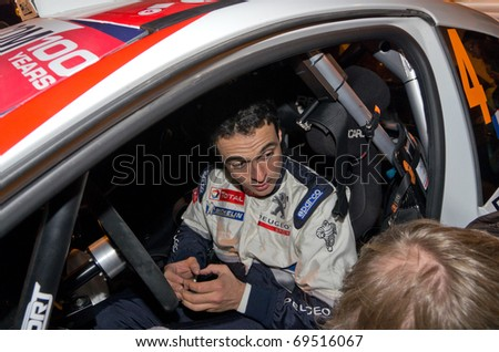 MONACO - JAN 21:  last day of the famous rally of montecarlo, here the french pilot bryan bouffier winner of the racing interviewed in monaco, on January 21, 2011 in Monaco, France