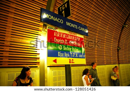 MONACO - MAY 07 2008:Passengers in Gare de Monaco-Monte-Carlo train station in Principality of Monaco.There are no airports in Monaco and the only way to get to Monaco is by railroad, roads or the sea - stock photo