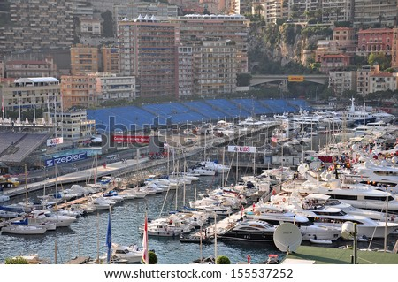 MONACO - MAY 24: Preparation for the qualifying races of Formula 1 Grand Prix de Monaco finishes, fashionable yachts are in port Hercules on May 24, 2012, Monaco                              - stock photo