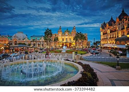 Monaco, Monte-Carlo, 04.09.2015: Casino Monte-Carlo in the night, hotel de Paris, night illumination, luxury cars, players, tourists, fountain, cafe de paris, long exposure, summer - stock photo