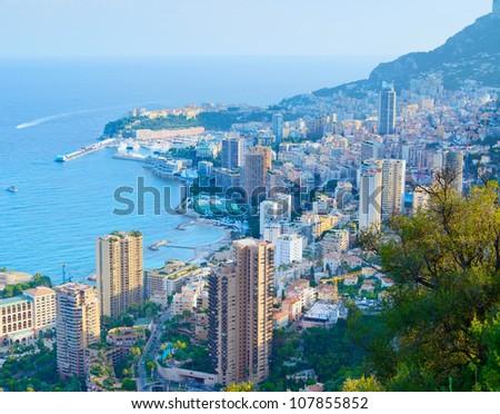 Monaco Montecarlo principality aerial view cityscape on sunset. Skyscrapers, coastline, port and old city. Azure coast. France, Europe. - stock photo