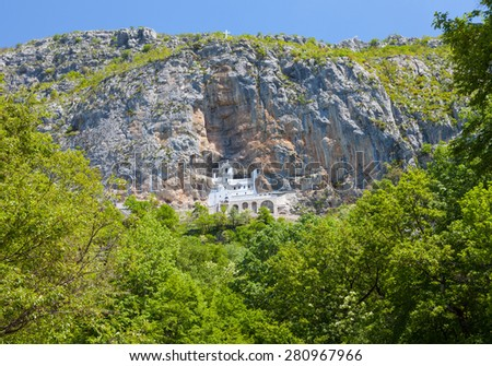 Monastery of Ostrog is a monastery of Serbian Orthodox Church placed against an almost vertical rock of Ostroska Greda, Montenegro, Europe. - stock photo