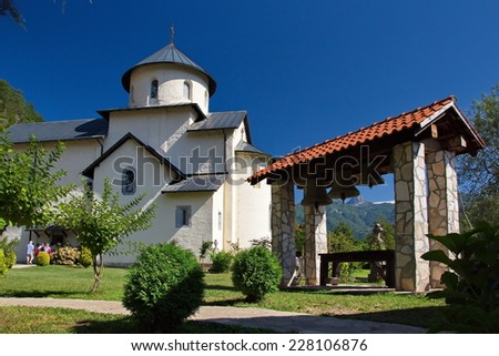 Monastic church with a belltower in mountains on the Balkans.
