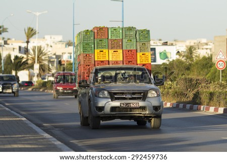 MONASTIR, TUNISIA - May 22, 2015: Common practice of loading a pickup truck to the max and driving it on the road. Tunisia, May 22, 2015 - stock photo