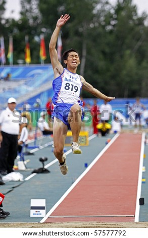 MONCTON, CANADA - JULY 20: Ching-Hsuan Lin of Chinese Taipei (TPE) performs the long jump during the 2010 IAAF World Junior Championships on July 20, 2010 in Moncton, Canada.