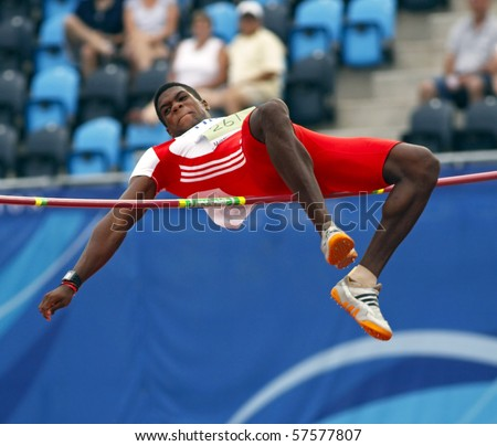 MONCTON, CANADA - JULY 20: Jose Angel Mendieta of Cuba performs the high jump as part of the decathlon during the 2010 IAAF World Junior Championships on July 20, 2010 in Moncton, Canada. - stock photo