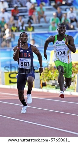 MONCTON, CANADA - JULY 21: Michael Granger (881) of USA and Patrick Fakiye of Australia run the men's 100 metres at the 2010 IAAF World Junior Championships on July 21, 2010 in Moncton, Canada.
