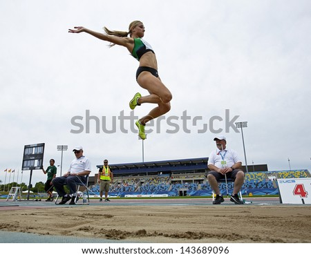 MONCTON, CANADA - June 22: Brianne Theisen competes in the heptathlon long jump at the Canadian Track & Field Championships June 22, 2013 in Moncton, Canada. - stock photo