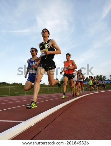 MONCTON, CANADA - June 28: Cameron Levins is followed by Jeremie Pellerin and Lucas Bruchet in the men's 5000-metre at the Canadian Track & Field Championships June 28, 2014 in Moncton, Canada. - stock photo